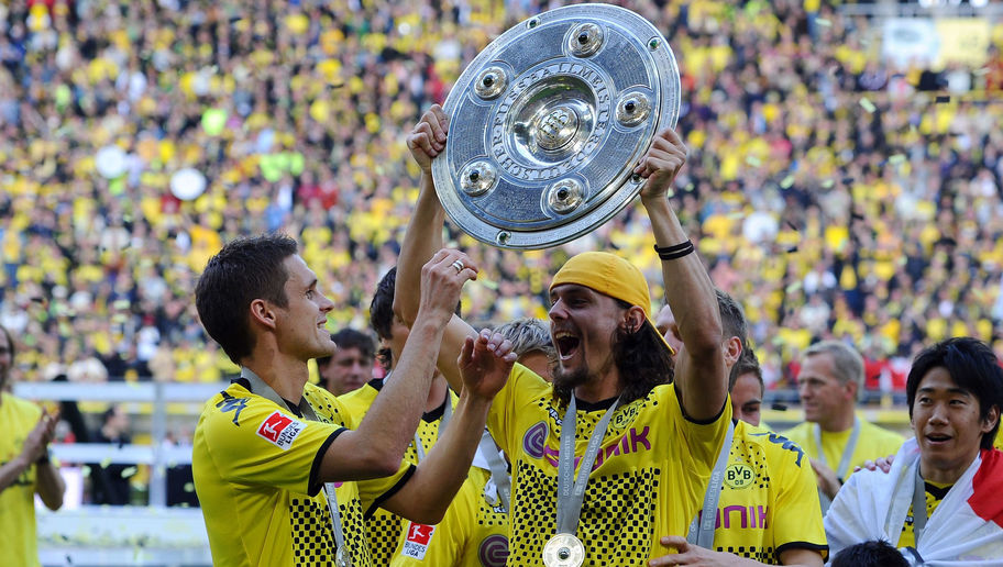 DORTMUND, GERMANY - MAY 14: Neven Subotic of Dortmund lifts the trophy after the Bundesliga match between Borussia Dortmund and Eintracht Frankfurt at Signal Iduna Park on May 14, 2011 in Dortmund, Germany. (Photo by Lars Baron/Bongarts/Getty Images)